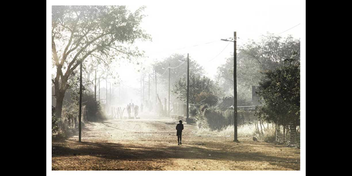 African village scene of kids walking to school